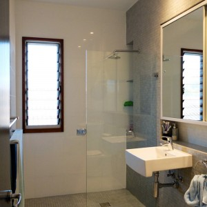 Bathroom with mosaic floor tiles