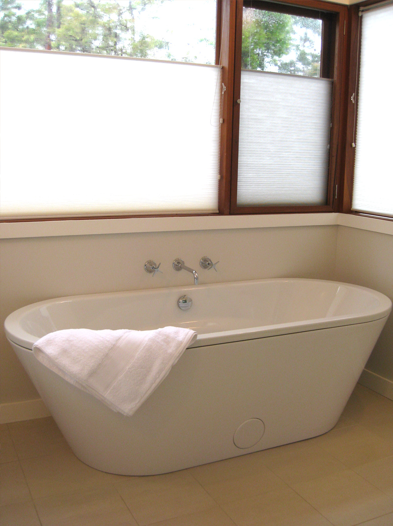 Bathroom showing freestanding bathtub