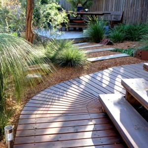 Curved decking path to garden