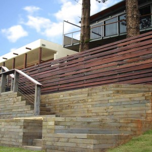View of rear of house showing extensive retaining walls