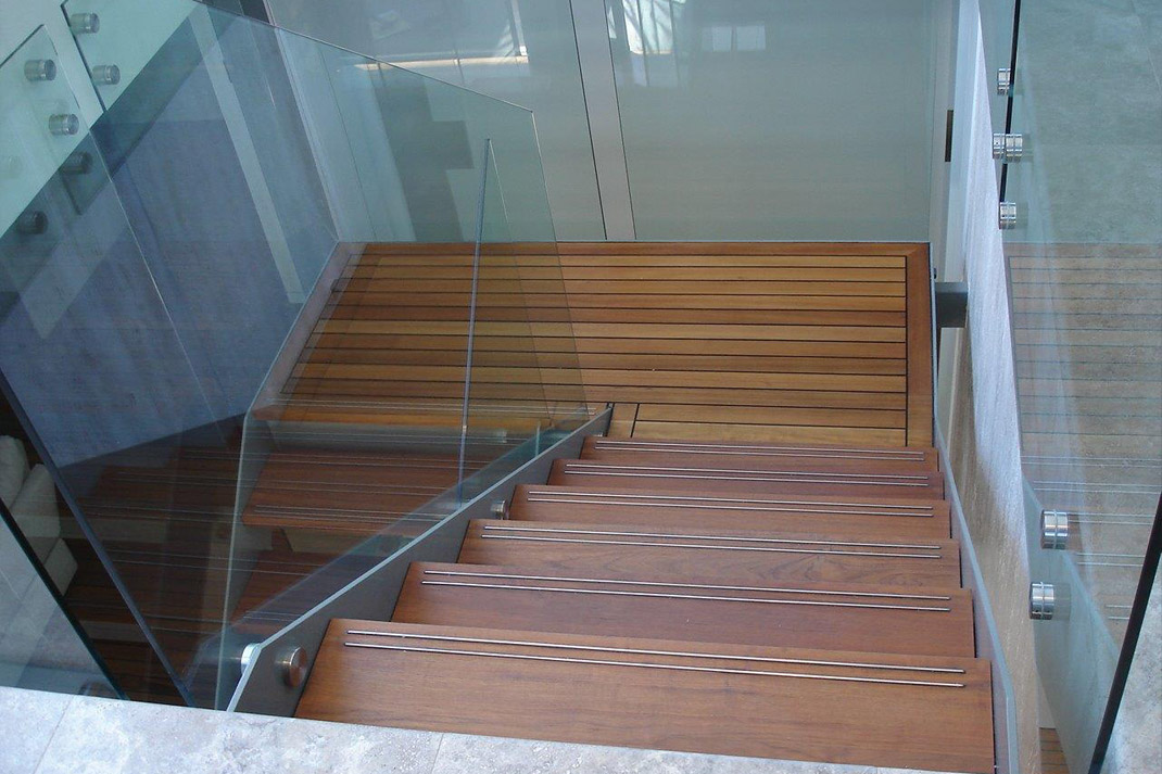 Glass balustrading and teak flooring to stairway